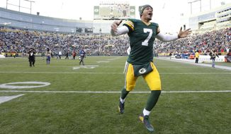 Green Bay Packers' Brett Hundley celebrates after overtime of an NFL football game against the Tampa Bay Buccaneers Sunday, Dec. 3, 2017, in Green Bay, Wis. The Packers won 26-20. (AP Photo/Mike Roemer)