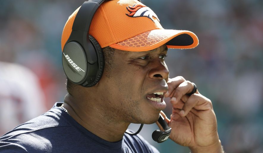 Denver Broncos head coach Vance Joseph talks on the sidelines, during the first half of an NFL football game against the Miami Dolphins, Sunday, Dec. 3, 2017, in Miami Gardens, Fla. (AP Photo/Lynne Sladky)