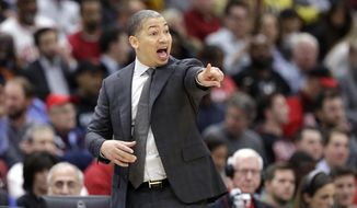 Cleveland Cavaliers' Tyronn Lue directs his team during the first half of an NBA basketball game against the Chicago Bulls Monday, Dec. 4, 2017, in Chicago. (AP Photo/Charles Rex Arbogast)