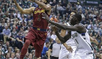FILE - In this Oct. 20, 2017, file photo, Cleveland Cavaliers' Derrick Rose drives against Milwaukee Bucks' Thon Maker, right, during the first half of an NBA basketball game, in Milwaukee. Estranged point guard Derrick Rose has returned to the Cavaliers. The former NBA MVP left the team on Nov. 9 after being sidelined with a sprained left ankle. His latest injury had Rose contemplating whether to continue playing, but the Cavs said Monday, Dec. 4, 2017, that Rose has rejoined the team to resume treatment and rehabilitation. (AP Photo/Tom Lynn, File)