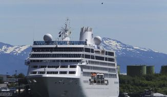 FILE - This June 26, 2014, file photo, shows a cruise ship docked in Juneau, Alaska, while a paraglider soars above. The tax bill approved Saturday, Dec. 2, 2017, by the U.S. Senate will open part of the Arctic National Wildlife Refuge to oil and gas drilling. The measure also struck down a proposed cruise ship tax that Republican Sen. Lisa Murkowski said would have disproportionately affected her state. (AP Photo/Becky Bohrer, File)