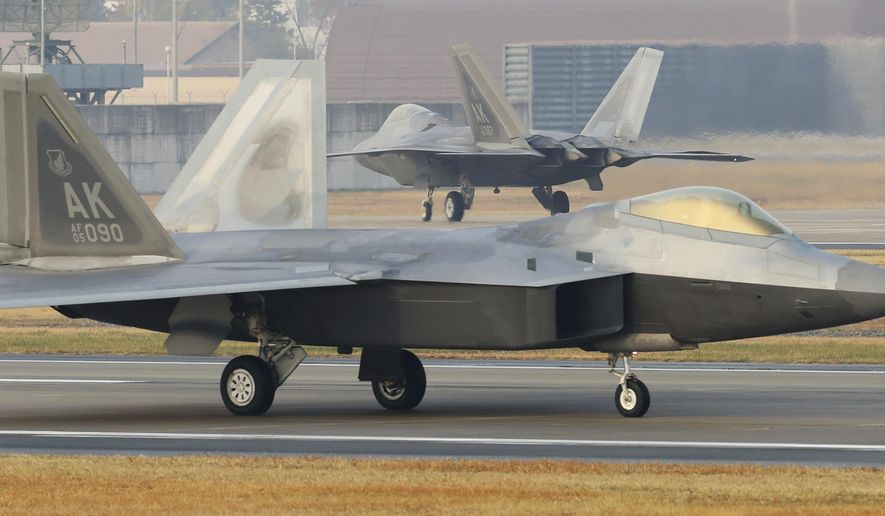 CORRECTS TO REMOVE REFERENCE TO BIGGEST-EVER JOINT EXERCISE - U.S. Air Force F-22 Raptors taxi on the runway upon landing at a South Korean air base in Gwangju, South Korea, Monday, Dec. 4, 2017. The United States and South Korea have started their joint air force exercise with hundreds of aircrafts including two dozen stealth jets. (Yonhap via AP)