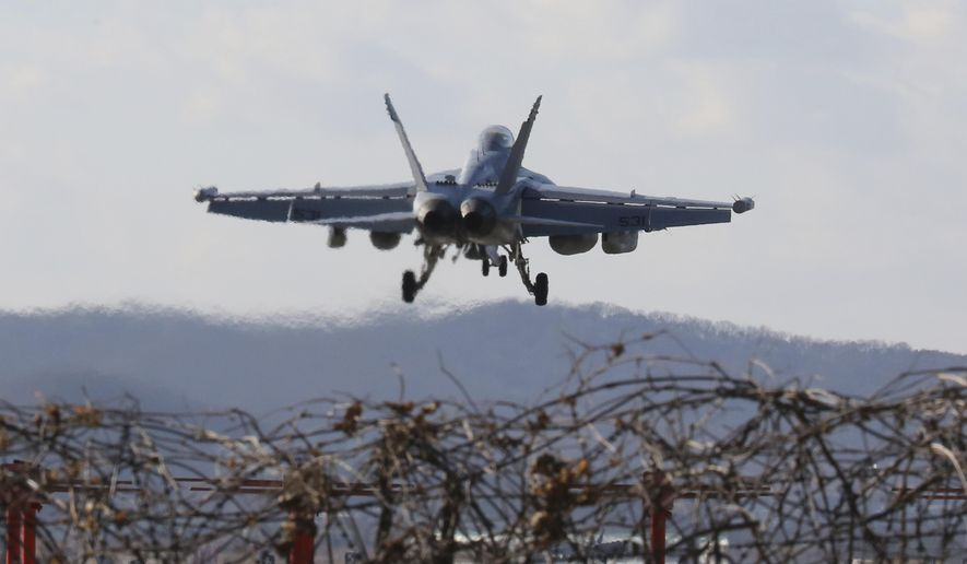 A U.S. Air Force EA-18G Growler fighter jet prepares to land at the Osan U.S. Air Base in Pyeongtaek, South Korea, Monday, Dec. 4, 2017. Hundreds of aircrafts including two dozen stealth jets began training Monday as the United States and South Korea launched their combined air force exercise. (AP Photo/Ahn Young-joon)