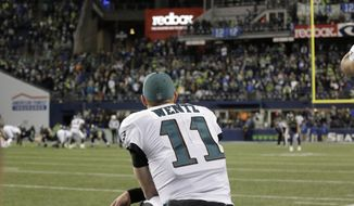 Philadelphia Eagles quarterback Carson Wentz looks on from the sidelines for the final moments in the second half of an NFL football game against the Seattle Seahawks, Sunday, Dec. 3, 2017, in Seattle. The Seahawks won 24-10. (AP Photo/John Froschauer)
