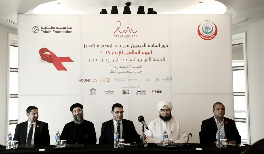 In this Saturday, Dec. 2, 2017 photo, from left to right UNAIDS country manager Ahmed Khamis, Christian father Boulos Soror, Dr. Walid Kamal, Islamic scholar and Sheik Ali al-Jifri, and Tabah Foundation member Mohammed Shahin, prepare for an even part of the World AIDS Day 2017 national advocacy campaign at a hotel, in Cairo, Egypt. An alarming HIV epidemic is silently spreading in Egypt, with an annual growth of up to 40 percent and funds to deal with the crisis running out by next year, U.N. officials and activists say. (AP Photo/Nariman El-Mofty)