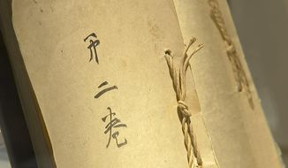 In this image from an Associated Press video, one volume of a two-volume, 173-page, post-World War II memoir composed by Japanese Emperor Hirohito is displayed at Bonhams Monday, Dec. 4, 2017, in New York. The document was dictated by the Emperor to aides after the war and transcribed word-for-word by a senior diplomat. It was created at the request of Gen. Douglas MacArthur, whose administration controlled Japan at the time. The memoir, also known as the imperial monologue, covers events from the Japanese assassination of Manchurian warlord Zhang Zuolin in 1928 to the emperor's surrender broadcast recorded on Aug. 14, 1945. It is expected to fetch between $100,000 and $150,000 at Bonhams' auction Dec. 6. (AP Photo/Joseph B. Frederick)