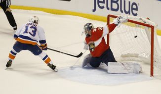 New York Islanders center Mathew Barzal (13) scores against Florida Panthers goalie James Reimer (34) during a shootout in an NHL hockey game, Monday, Dec. 4, 2017, in Sunrise, Fla. The Islanders defeated the Panthers 5-4 in a shootout. (AP Photo/Wilfredo Lee)