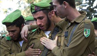 "Israeli soldiers mourn during the funeral of Israeli soldier Ron Yitzhak Kokia, at Kiryat Shaul military cemetery in Tel Aviv, Israel, Sunday, Dec. 3, 2017. Kokia was stabbed to death on Thursday evening in the southern city of Arad, in what police said was a ""terror attack."" (AP Photo/Ariel Schalit)"