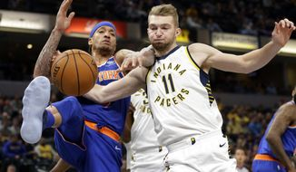 New York Knicks forward Michael Beasley (8) and Indiana Pacers center Domantas Sabonis (11) fight for a rebound during the first half of an NBA basketball game in Indianapolis, Monday, Dec. 4, 2017. (AP Photo/Michael Conroy)