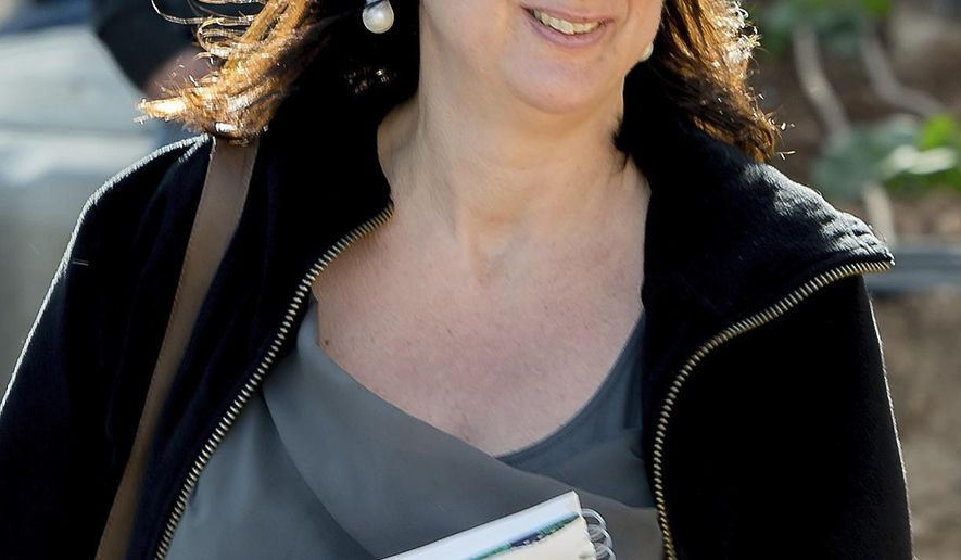 FILE -- This April 4, 2016 file photo shows Maltese investigative journalist Daphne Caruana Galizia, who was killed by a car bomb in Malta on Oct. 16. On Monday, Dec. 4, 2017 Malta's prime minister Joseph Muscat announced the arrest of eight suspects, all Maltese citizens, in the murder of the journalist. (AP Photo/Jon Borg, files)