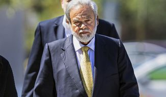 FILE- In this April 28, 2017 file photo, Dr. Salomon Melgen arrives at the federal courthouse in West Palm Beach, Fla. Prosecutors say Melgen, a prominent Florida eye doctor who was accused of bribing New Jersey Democratic Sen. Bob Menendez, should get a 30-year sentence for Medicare fraud. A three-day sentencing hearing for Melgen is scheduled to begin Tuesday, Dec. 5, 2017, in West Palm Beach on 67 counts. Prosecutors say the 63-year-old doctor stole more than $100 million from the federal government. He was convicted in April after a 2 1/2- month trial.(Lannis Water/Palm Beach Post via AP, File)