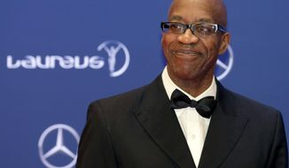 FILE - In this April 18, 2016, file photo, Edwin Moses poses for photos as he arrives for the Laureus World Sports Awards in Berlin, Germany. Three months after suffering the second of two traumatic head injuries in the span of six weeks, Edwin Moses is nearing 100 percent again. It's been an amazing recovery for one of America's best-known Olympic stars, and a man who is no stranger to making the impossible seem possible. (AP Photo/Markus Schreiber, File)