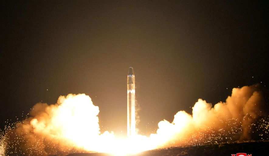 """FILE - This Wednesday, Nov. 29, 2017, file image provided by the North Korean government on Thursday, Nov. 30, 2017, shows what the North Korean government calls the Hwasong-15 intercontinental ballistic missile, at an undisclosed location in North Korea. Cathay Pacific said in a statement Monday, Dec. 4, the crew on a San Francisco-to-Hong Kong flight reported witnessing the apparent re-entry of the ICBM that North Korea launched before dawn Wednesday. Independent journalists were not given access to cover the event depicted in this image distributed by the North Korean government. The content of this image is as provided and cannot be independently verified. Korean language watermark on image as provided by source reads: """"KCNA"""" which is the abbreviation for Korean Central News Agency. (Korean Central News Agency/Korea News Service via AP)"""