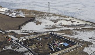 This Feb. 13, 2017, aerial file photo shows a site where the final phase of the Dakota Access Pipeline near the Missouri River took place with boring equipment routing the pipeline underground and across Lake Oahe to connect with the existing pipeline in Emmons County in Cannon Ball, N.D. A federal judge on Monday, Dec. 4, 2017, ordered the Army Corps of Engineers and pipeline developer Energy Transfer Partners to complete an oil spill response plan for a section of the pipeline beneath the Missouri River in North Dakota. (Tom Stromme/The Bismarck Tribune via AP, File)