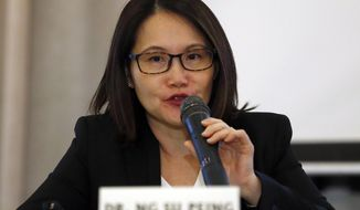 Dr. Ng Su-Peing, global medical head at Sanofi Pasteur, the manufacturer of dengue vaccine Dengvaxia, speaks at a news conference in suburban Taguig city, east of Manila, Philippines Monday, Dec. 4, 2017. The manufacturer of the dengue vaccine whose use was suspended by the Philippines last week after a study showed risks of severe cases in people without previous infection says it is working to resolve those fears. (AP Photo/Bullit Marquez)