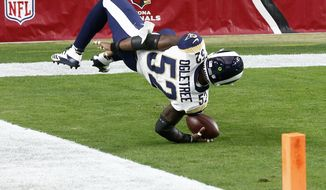 Los Angeles Rams inside linebacker Alec Ogletree (52) falls into the end zone after an interception for a touchdown against the Arizona Cardinals during the first half of an NFL football game, Sunday, Dec. 3, 2017, in Glendale, Ariz. (AP Photo/Ross D. Franklin)