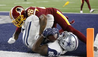 """FILE - In this Nov. 30, 2017, file photo, Washington Redskins cornerback Bashaud Breeland (26) lands on top of Dallas Cowboys wide receiver Dez Bryant (88) after Bryant caught a pass for a touchdown in the second half of an NFL football game, in Arlington, Texas. Informed that one estimation gives his Washington Redskins a 1 percent chance of making the playoffs, cornerback Bashaud Breeland opted to take a rose-colored view of the situation. """"So we still have something we can play for,"""" Breeland said after an abbreviated practice Monday, Dec. 4, 2017. """"It's not all the way out of our grasp.""""(AP Photo/Ron Jenkins, File)"""