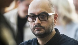 FILE - In this file photo taken on Monday, Sept. 4, 2017, Russia's theater and film director Kirill Serebrennikov waits for the start of hearings in a court in Moscow, Russia. A Moscow court  ruled  Monday Dec. 4, 2017  to keep a prominent theater and film director who is being investigate for fraud under house arrest. (AP Photo/Pavel Golovkin, File)