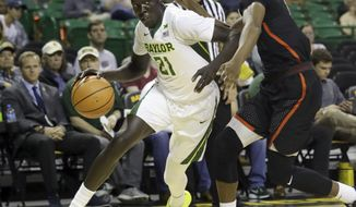Baylor forward Nuni Omot (21) drives against Sam Houston State guard Dillon Todd (10) during the first half of an NCAA college basketball game in Waco, Texas, Monday, Dec. 4, 2017. (AP Photo/LM Otero)