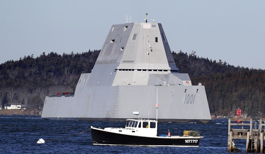 The future USS Michael Monsoor passes Fort Popham travels down the Kennebec River as it heads out to sea for trials, Monday, Dec. 4, 2017, in Phippsburg, Maine. The ship is the second in the stealthy Zumwalt class of destroyers. (AP Photo/Robert F. Bukaty)