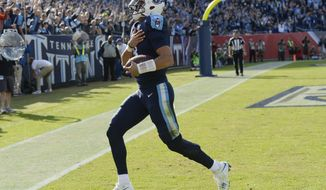 Tennessee Titans quarterback Marcus Mariota scores a touchdown on a 9-yard run against the Houston Texans in the first half of an NFL football game Sunday, Dec. 3, 2017, in Nashville, Tenn. (AP Photo/Mark Zaleski)