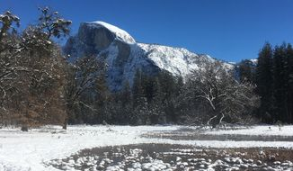 This undated image provided by the National Park Service shows the famous Half Dome granite formation in Yosemite National Park in California in winter. The park is less crowded in winter and offers solitude, scenery and activities like hiking, snowshoeing, skiing and ice skating. (NPS Photo via AP)