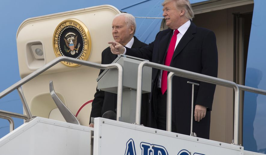 President Donald Trump stands with Sen. Orrin Hatch, R-Utah, after arriving at Salt Lake City International Airport, Monday, Dec. 4, 2017, in Salt Lake City. (AP Photo/Evan Vucci)