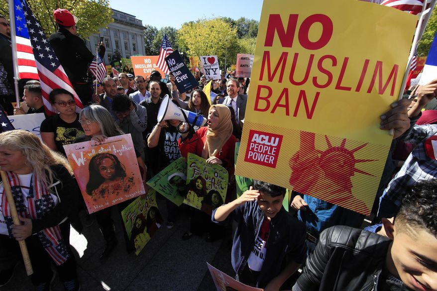 Despite crowds of protesters, only two justices on the Supreme Court dissented with a decision to allow the Trump administration to fully enforce a ban on travel to the United States by residents of six mostly Muslim countries. (Associated Press)