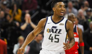 Utah Jazz guard Donovan Mitchell (45) celebrates a basket against the Washington Wizards in the first half during of an NBA basketball game Monday, Dec. 4, 2017, in Salt Lake City. (AP Photo/Alex Goodlett)