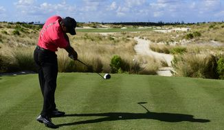 Tiger Woods tees off from the 14th hole during the final round of the Hero World Challenge golf tournament at Albany Golf Club in Nassau, Bahamas, Sunday, Dec. 3, 2017. (AP Photo/Dante Carrer)