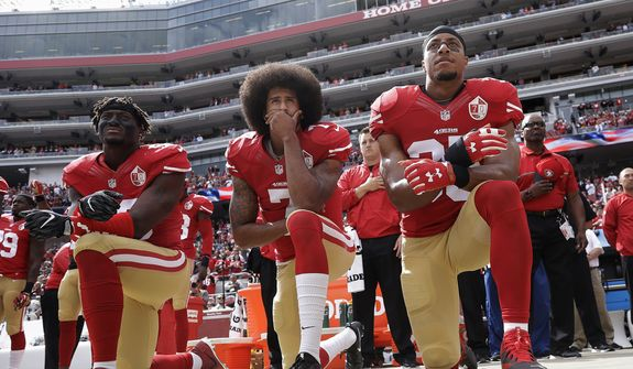 """FILE - In this Oct. 2, 2016, file photo, San Francisco 49ers outside linebacker Eli Harold, left, quarterback Colin Kaepernick, center, and safety Eric Reid kneel during the national anthem before the team's NFL football game against the Dallas Cowboys in Santa Clara, Calif. Kaepernick accepted Sports Illustrated's Muhammad Ali Legacy Award from Beyonce on Tuesday night, Dec. 5, 2017, and promised that """"with or without the NFL's platform, I will continue to work for the people."""" Beyonce thanked Kaepernick for his """"personal sacrifice,"""" and 2016 Ali Award winner Kareem Abdul-Jabbar called Kaepernick a """"worthy recipient"""" during a video tribute.(AP Photo/Marcio Jose Sanchez, File)"""