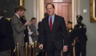 Sen. Pat Toomey, R-Pa., walks to the chamber following weekly strategy meetings, on Capitol Hill in Washington, Tuesday, Dec. 5, 2017. (AP Photo/J. Scott Applewhite)