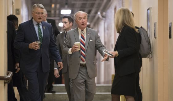 Rep. Rodney Frelinghuysen, R-N.J., chairman of the House Appropriations Committee, center, joined at left by Rep. Rick Allen R-Ga., arrives with fellow House Republicans for a closed-door strategy session on Capitol Hill in Washington, Tuesday, Dec. 5, 2017. (AP Photo/J. Scott Applewhite) ** FILE **