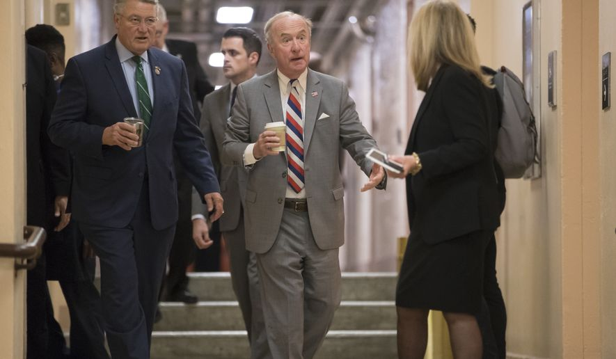 Rep. Rodney Frelinghuysen, R-N.J., chairman of the House Appropriations Committee, center, joined at left by Rep. Rick Allen R-Ga., arrives with fellow House Republicans for a closed-door strategy session as the deadline looms to pass a spending bill to fund the government by week's end, on Capitol Hill in Washington, Tuesday, Dec. 5, 2017. (AP Photo/J. Scott Applewhite)