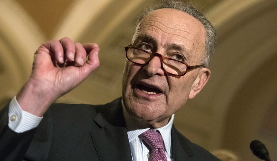 With the deadline looming to pass a spending bill to fund the government by week's end, Senate Minority Leader Chuck Schumer, D-N.Y., meets reporters following a closed-door strategy session, on Capitol Hill in Washington, Tuesday, Dec. 5, 2017. (AP Photo/J. Scott Applewhite)