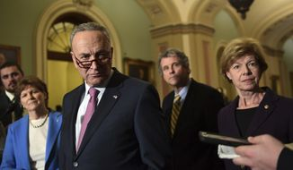 Senate Minority Leader Sen. Chuck Schumer of N.Y., center, listens to a reporters question on Capitol Hill in Washington, Tuesday, Dec. 5, 2017, following the Democrat's weekly policy luncheon. Schumer is joined by Sen. Jeanne Shaheen, D-N.H., second from left, Sen. Sherrod Brown, D-Ohio, second from right, and and Sen. Tammy Baldwin, D-Wis., right. (AP Photo/Susan Walsh)