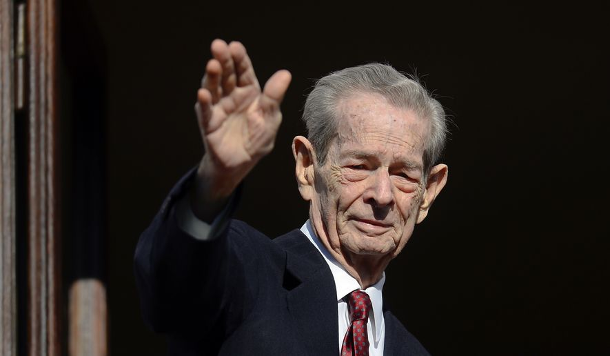 In this Friday, Nov. 8, 2013, file photo, former Romanian King Michael waves to supporters during an appearance for his name day at his residence, the Elisabeta Palace in Bucharest, Romania. Romania's royal house says former King Michael, who ruled Romania during WWII, has died, Tuesday, Dec. 5, 2017, in Switzerland aged 96. (AP Photo/Octav Ganea, File)