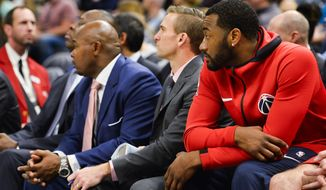 Washington Wizards guard John Wall looks on from the bench in the second half of an NBA basketball game against the Utah Jazz Monday, Dec. 4, 2017, in Salt Lake City. The Jazz won 116-69. (AP Photo/Alex Goodlett)