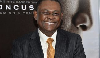 """FILE - In this Dec. 16, 2015 file photo, Dr. Bennet Omalu attends a special screening of """"Concussion"""" in New York. Omalu, a pathologist best known for researching NFL brain injuries, resigned Tuesday, Dec. 5, 2017, from the San Joaquin County coroner's office accusing Sheriff-Coroner Steve Moore of interfering with death investigations to protect law enforcement officers.  (Photo by Evan Agostini/Invision/AP, File)"""