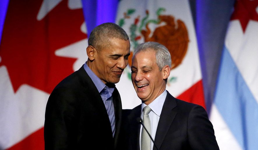 Former U.S. President Barack Obama, left, shares a laugh with Chicago Mayor Rahm Emanuel after Emanuel introduced Obama at a summit on climate change involving mayors from around the globe Tuesday, Dec. 5, 2017, in Chicago. The conference comes after President Trump said the U.S. will pull out of the Paris agreement. (AP Photo/Charles Rex Arbogast) ** FILE **