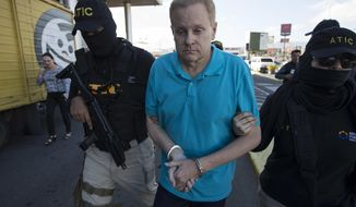 Eric Conn is escorted by SWAT team agents prior to his extradition, at the Toncontin International Airport, in Tegucigalpa, Honduras, Tuesday, Dec. 5, 2017. Conn, a fugitive Kentucky lawyer who escaped before facing sentencing for his central role in a massive Social Security fraud case, was captured as he came out of a restaurant in the coastal city of La Ceiba, on Monday. (AP Photo/Moises Castillo)