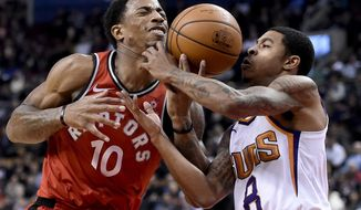 Toronto Raptors guard DeMar DeRozan (10) tries to drive to the net as Phoenix Suns guard Tyler Ulis (8) defends during the second half of an NBA basketball game Tuesday, Dec. 5, 2017, in Toronto. (Nathan Denette/The Canadian Press via AP)