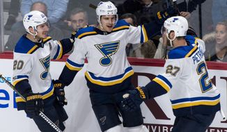 St. Louis Blues' Brayden Schenn, centre, celebrates his second goal with teammates Alexander Steen, left, and Alex Pietrangelo during the second period of an NHL hockey game against the Montreal Canadiens, Tuesday, Dec. 5, 2017 in Montreal. (Paul Chiasson/The Canadian Press via AP)