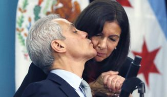 Chicago Mayor Rahm Emanuel, left, kisses Anne Hidalgo, mayor of Paris, goodbye at a news conference during a summit on climate change involving mayors from around the globe. The conference comes after President Trump said the U.S. will pull out of the Paris agreement.  (AP Photo/Charles Rex Arbogast)