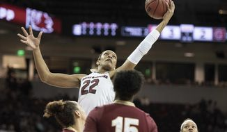 South Carolina forward A'ja Wilson (22) grabs a rebound against College of Charleston during the first half of an NCAA college basketball game Tuesday, Dec. 3, 2017, in Columbia, S.C. (AP Photo/Sean Rayford)