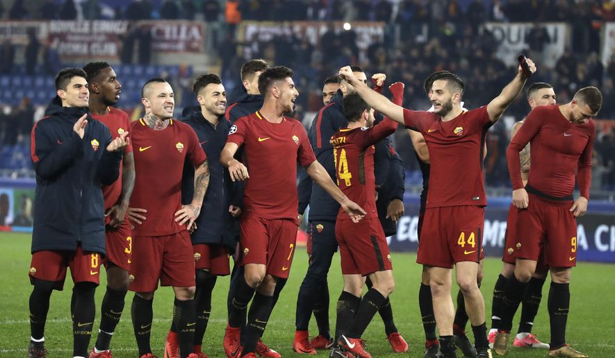 Roma players celebrate their victory at the end of the group C Champions League soccer match between Roma and Qarabag at the Stadio Olimpico in Rome, Italy, Tuesday, Dec. 5, 2017. (AP Photo/Alessandra Tarantino)