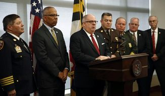Maryland Gov. Larry Hogan, center, speaks at a news conference alongside law enforcement and Hogan administration officials to announce proposals to fight crime in Baltimore, Tuesday, Dec. 5, 2017. Homicides in the city have topped 300 for the third consecutive year. (AP Photo/Patrick Semansky)