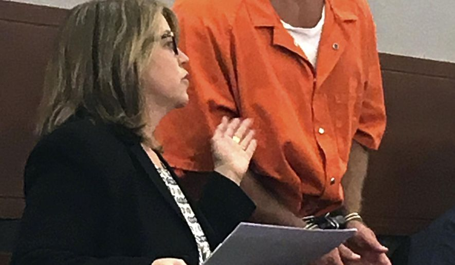 FILE - In this Aug. 17, 2017, file photo, Nevada death row inmate Scott Dozier, right, confers with Lori Teicher, a federal public defender involved in his case, during an appearance in Clark County District Court in Las Vegas. A judge left a condemned Nevada prison inmate's execution on hold over concerns about using a never-before-tried three-drug combination for Nevada's first execution in more than 11 years. With the Nevada Supreme Court expected to review the case and decide in coming months if Dozier's execution should go forward, Clark County District Court Judge Jennifer Togliatti said Tuesday, Dec. 5, 2017, she wants written filings on other issues. (AP Photo/Ken Ritter, File)