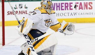 Nashville Predators goalie Juuse Saros watches a shot from the Dallas Stars during the first period of an NHL hockey game, Tuesday, Dec. 5, 2017, in Dallas. (AP Photo/Tony Gutierrez)