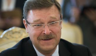 FILE - In this June 20, 2014 file photo, Konstantin Kosachev, head of a government agency in charge of relations with ex-Soviet nations, speaks at a news conference in Moscow, Russia. Kosachev said on Tuesday, Dec. 5, 2017 that he can't understand why President Donald Trump's former national security adviser Michael Flynn failed to immediately reveal the truth about his contacts with the Russian ambassador. (AP Photo/Alexander Zemlianichenko, File)